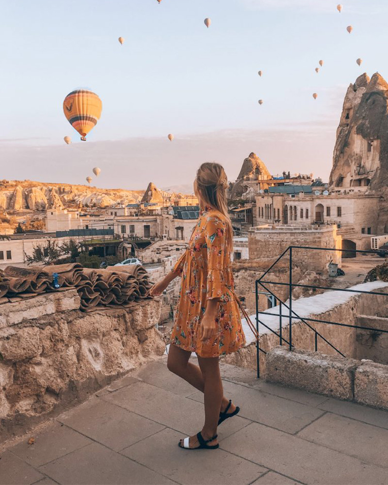 Me standing on my hotel watching the balloons in Cappadocia - best free thing to do!