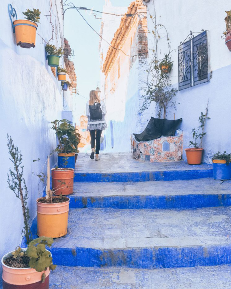 Me walking up steps in Chefchaouen