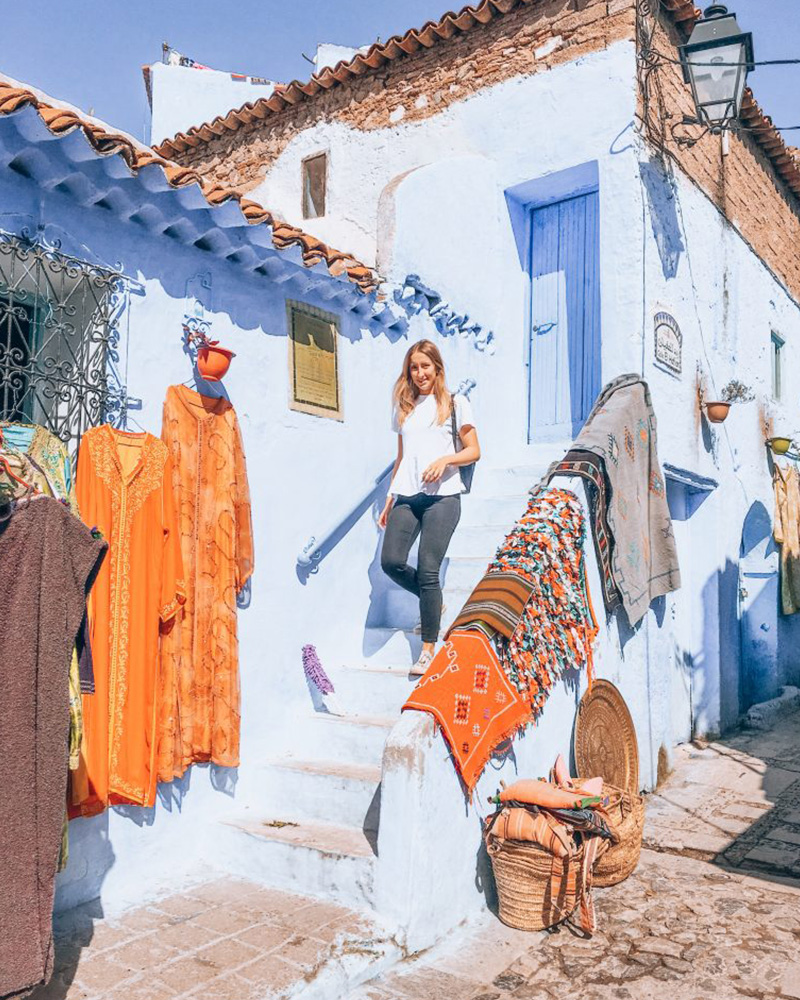 Another blue building in Chefchaouen! With orange rugs wither side
