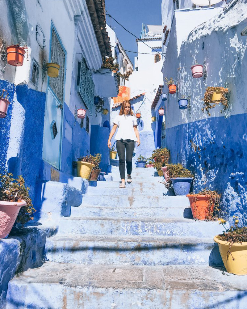 Me walking through the blue streets of Chefchaouen