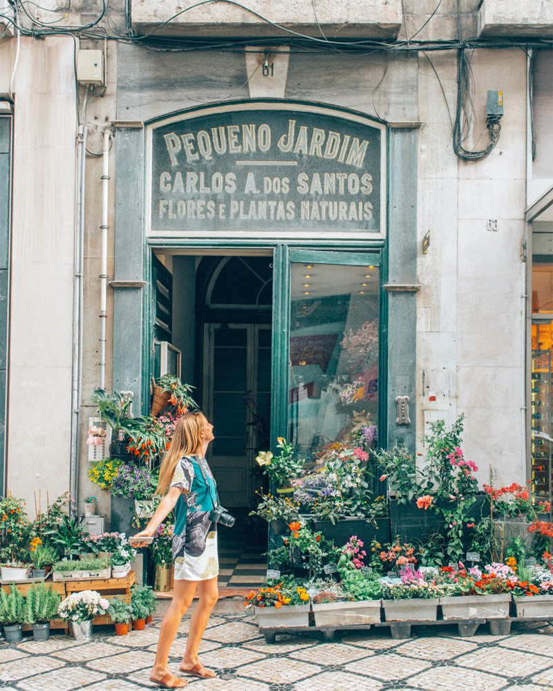 Me in front of a flower shop in Lisbon worth visiting