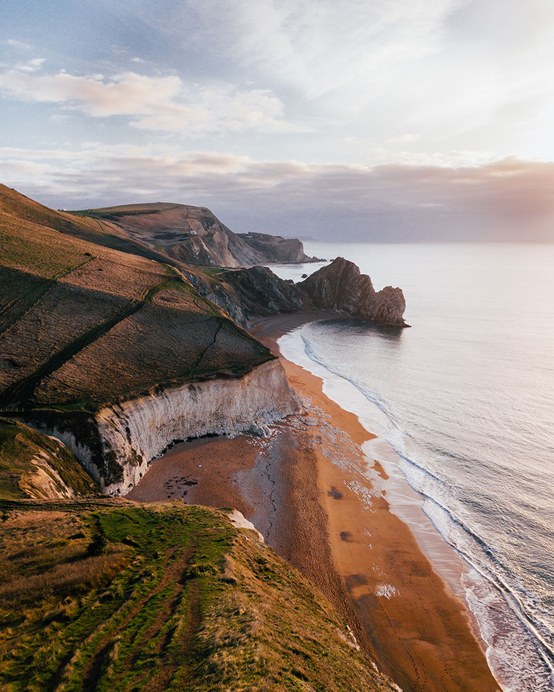 Durdle Door at sunrise from the drone in Dorset