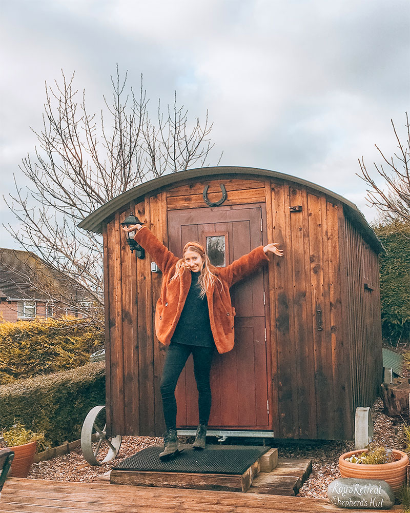 Me stood outside a hut in Dorset
