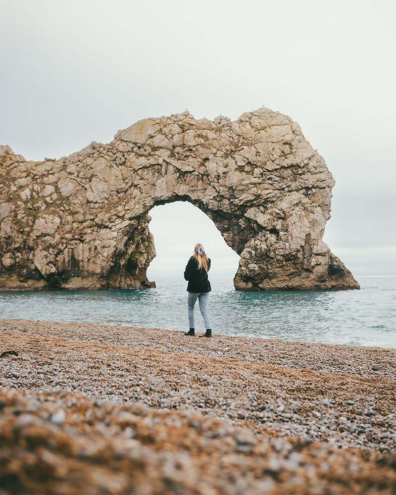 Me walking along the beach at Durdle Door in Dorset at winter