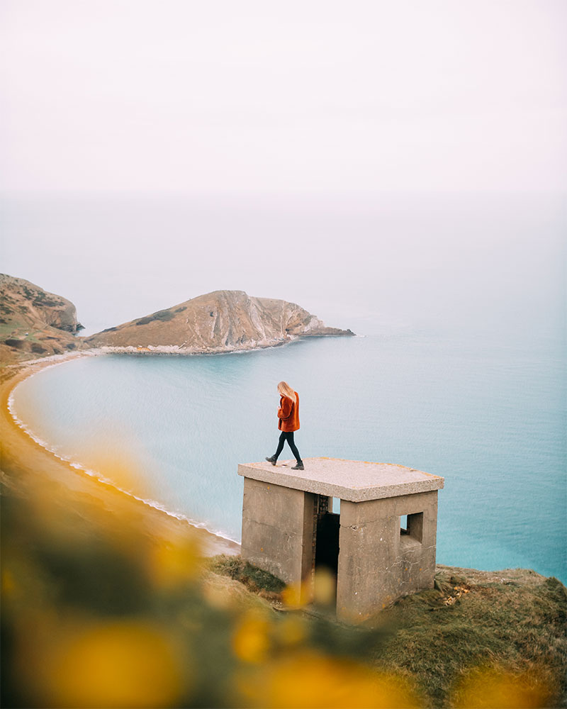 Me walking along a pill box at Worbarrow Bay