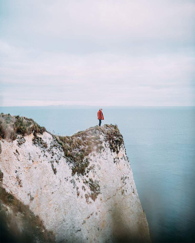Me stood on the edge of a rock in Dorset in Winter