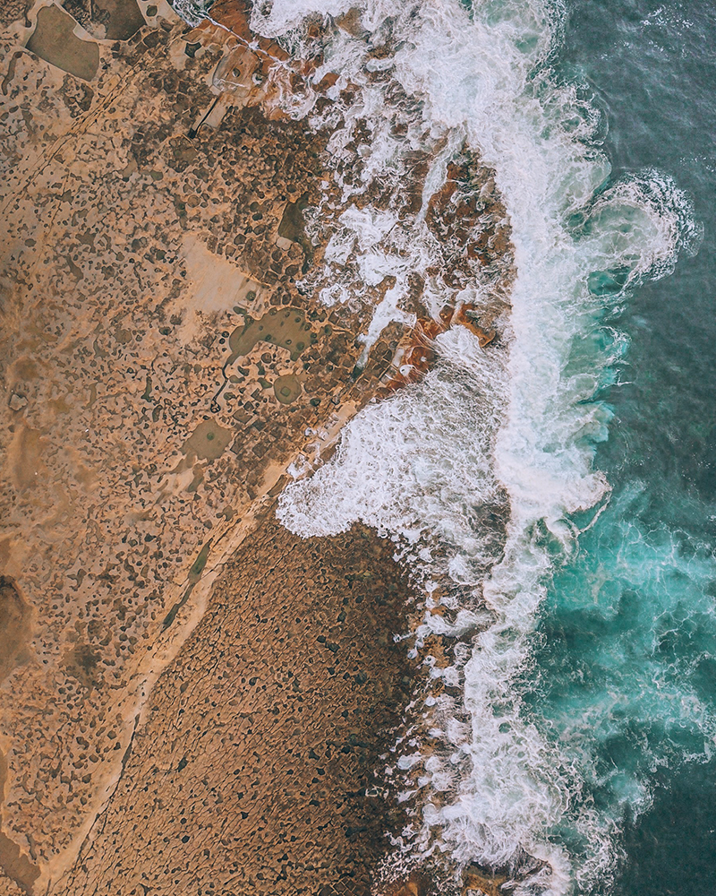 Drone shot of the coast line of Gozo