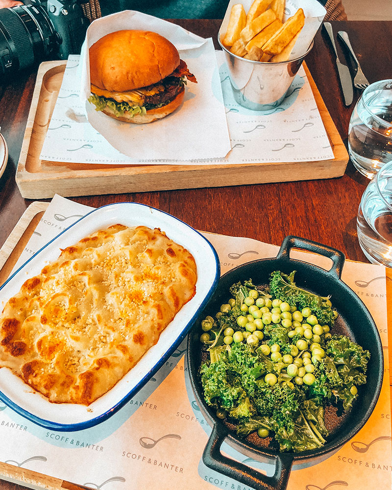 Main course - pie and greens with a burger and chips