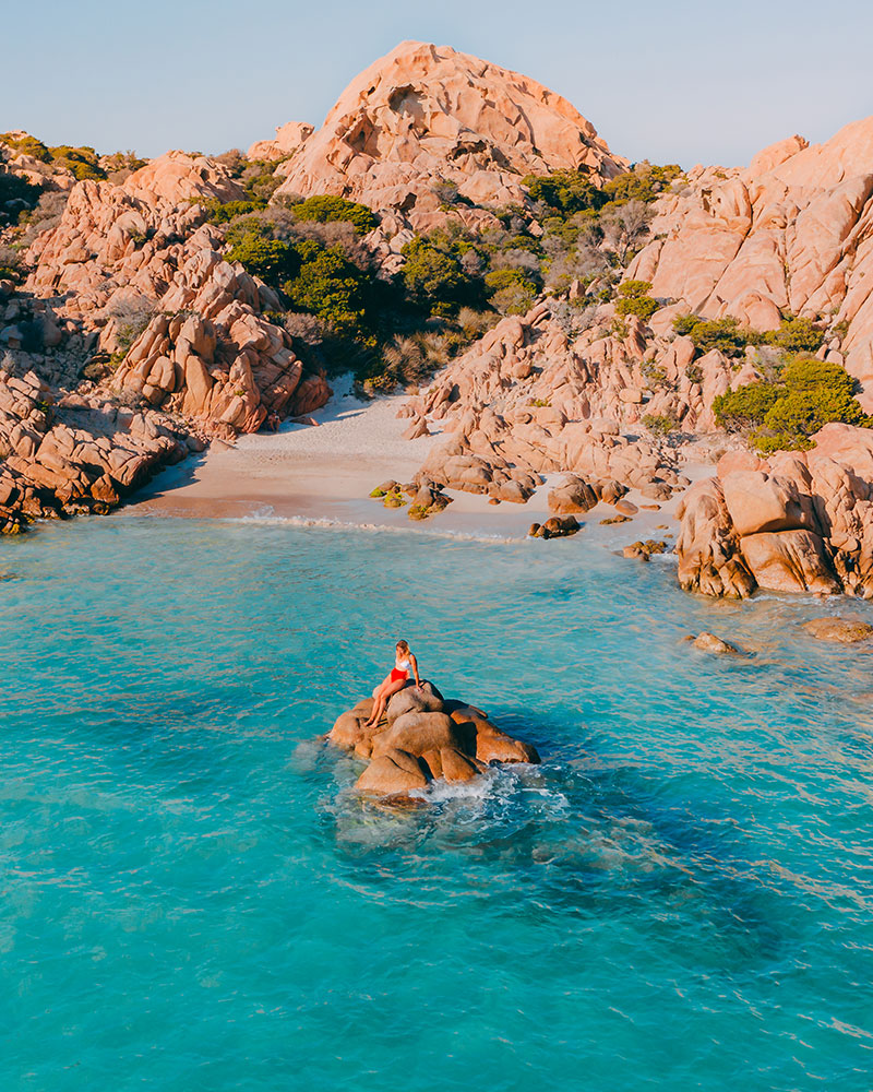Cala Coticcio in Sardinia, me on a rock in the water