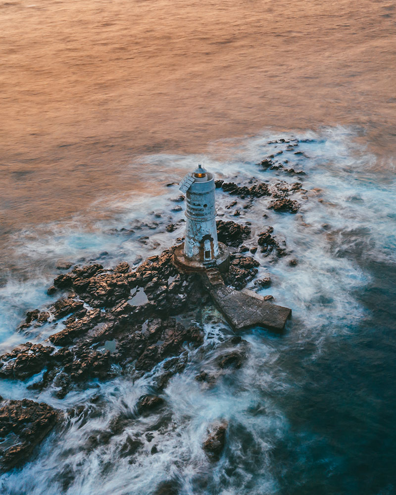 Drone shot of a lighthouse in Sardinia