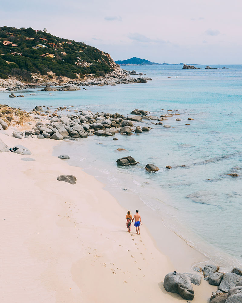Me and Boyan walking dow the beach in Sardinia, drone shot