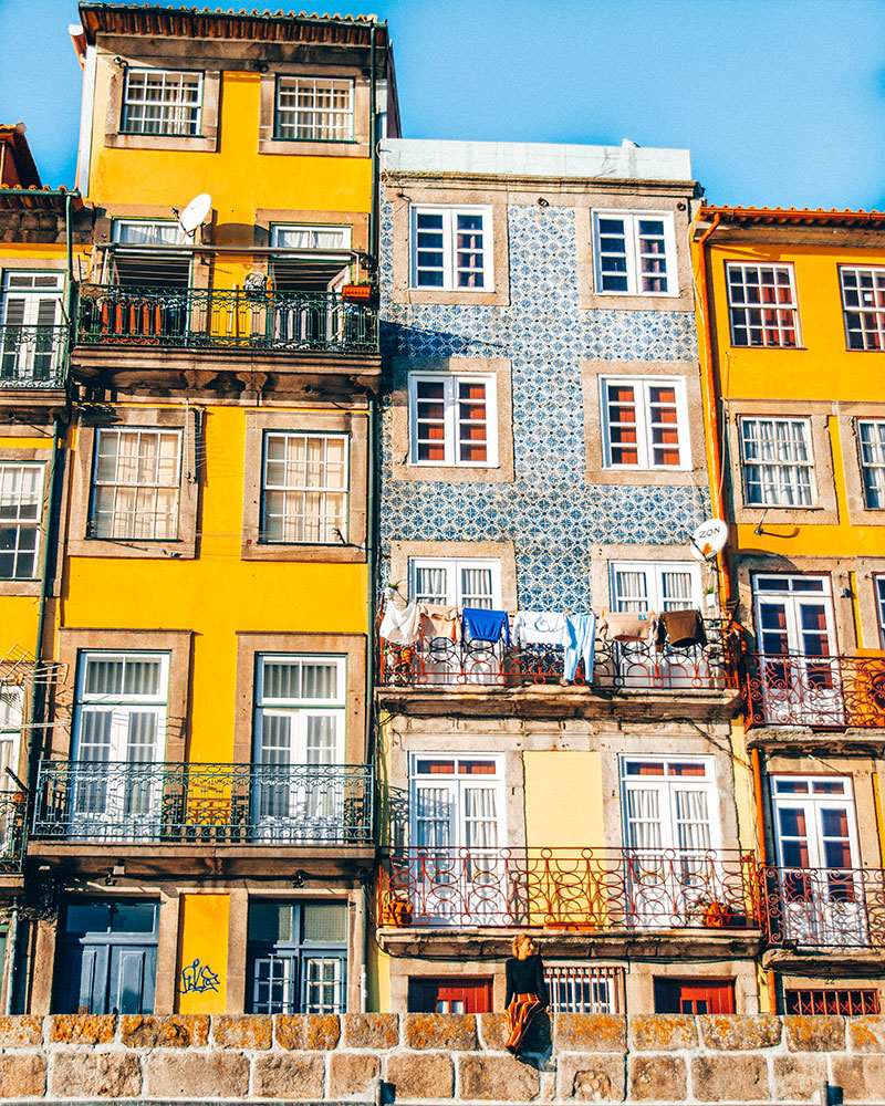 How to spend 3 days in porto - instagrammable spot near the bridge - houses with washing outside and blue sky