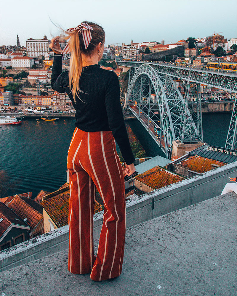 Overlooking the Dom Luis Bridge in porto -  girl stood looking