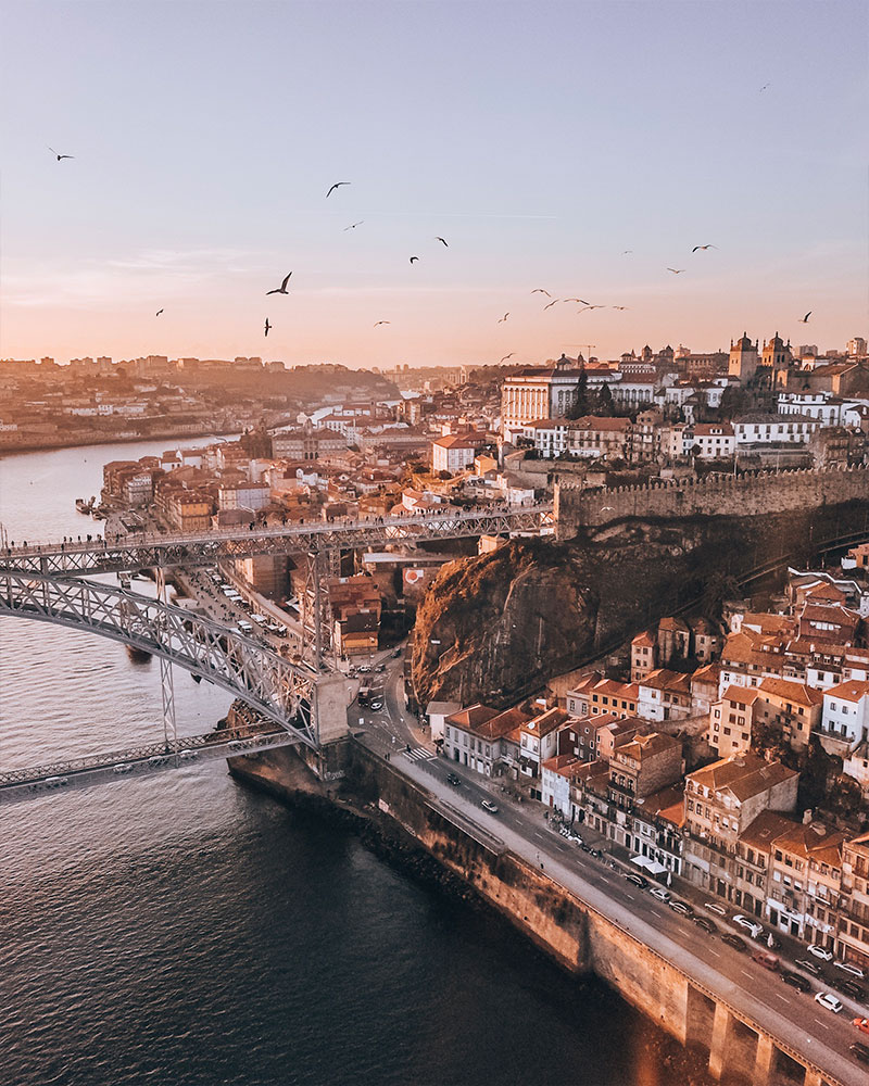 Drone shot of sunset over the bridge in Porto