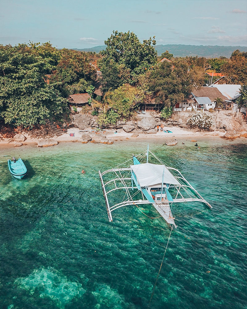 drone shot over Cebu island Philippines with boat and sea