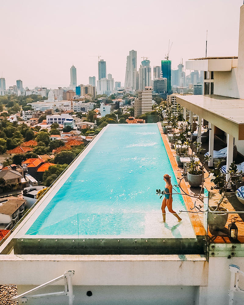 Me standing in the infinity pool at Jetwing Colombo 7 Hotel with a view over the city