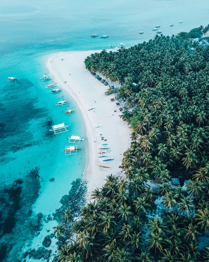 Drone shot of Daku island while island hopping in the philippines from siargao