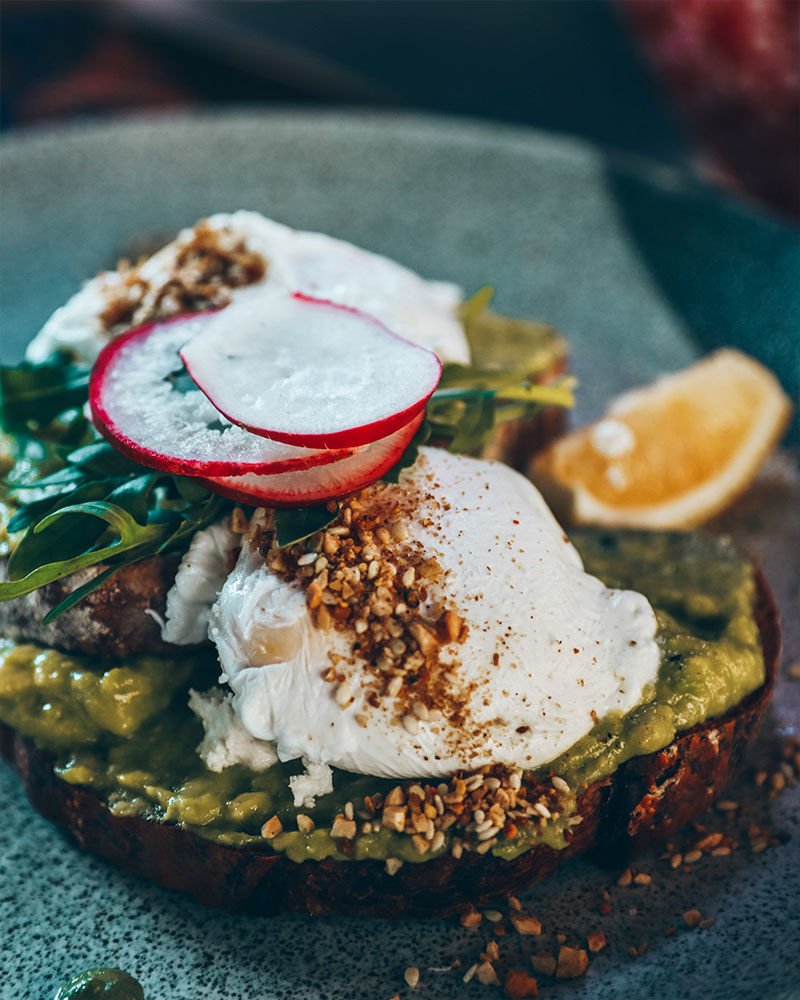 Poached eggs and smashed avocado on toast, The Drifter restaurant, Uluwatu, Bali, Indonesia