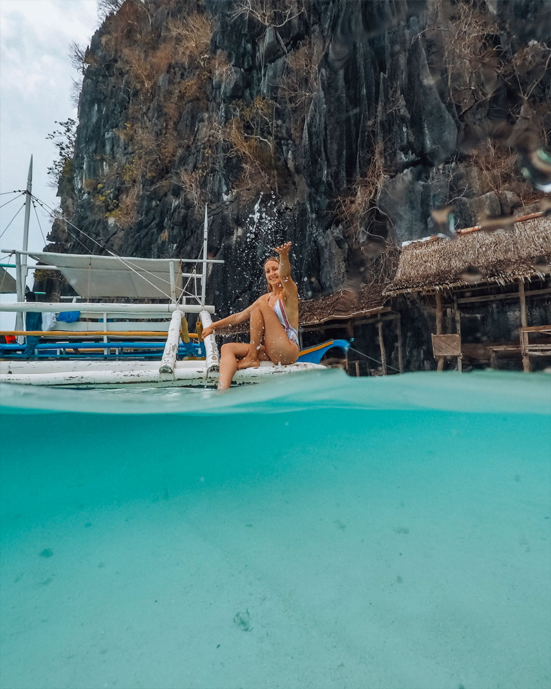 Me splashing water in a dome photo while island hopping in Coron, Philippines