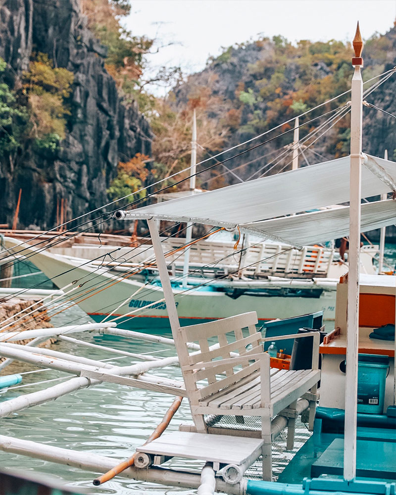 Boat trip in Coron, Philippines. View over Kayangan lake with boats