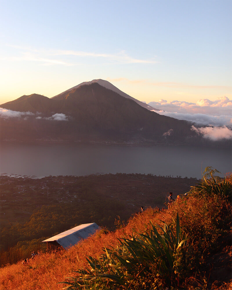 View from Mount Batur of the sunrise after hiking in Ubud, Bali, Indonesia