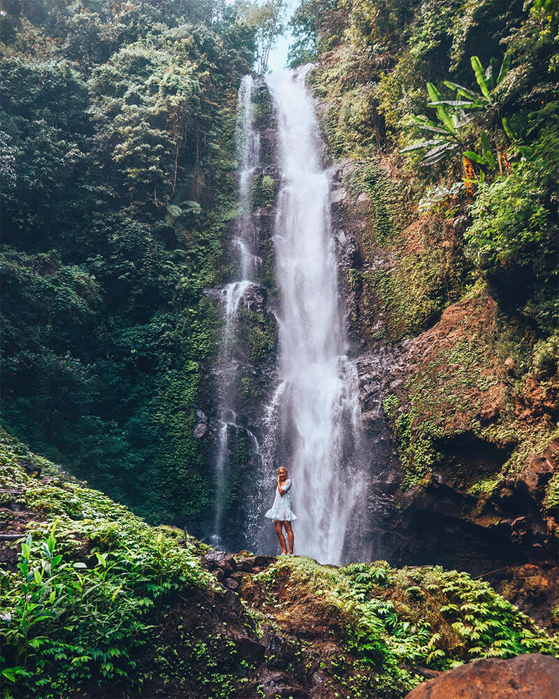 Munduk Waterfall in Bali with lush greenery around