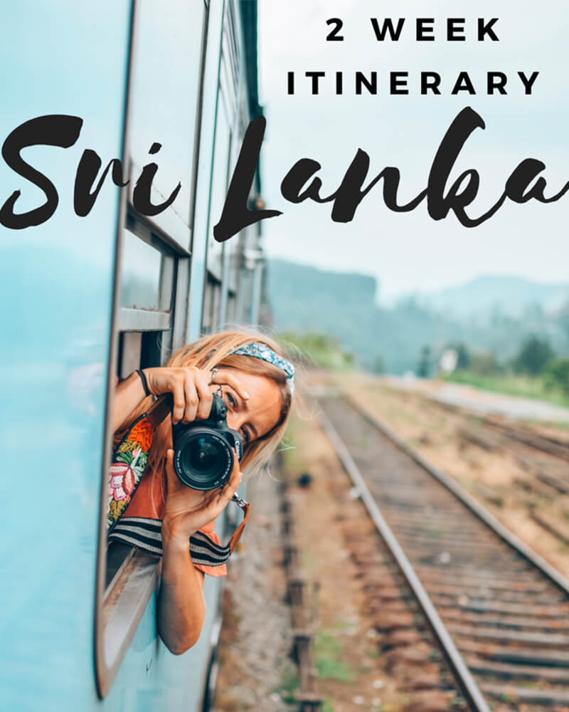 View of Ella Train, me leaning out with my camera in Sri Lanka