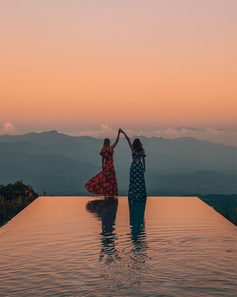 Me and Taylor twirling at the infinity pool at sunrise at Munduk moding Plantation Hotel, Munduk Bali, Indonesia