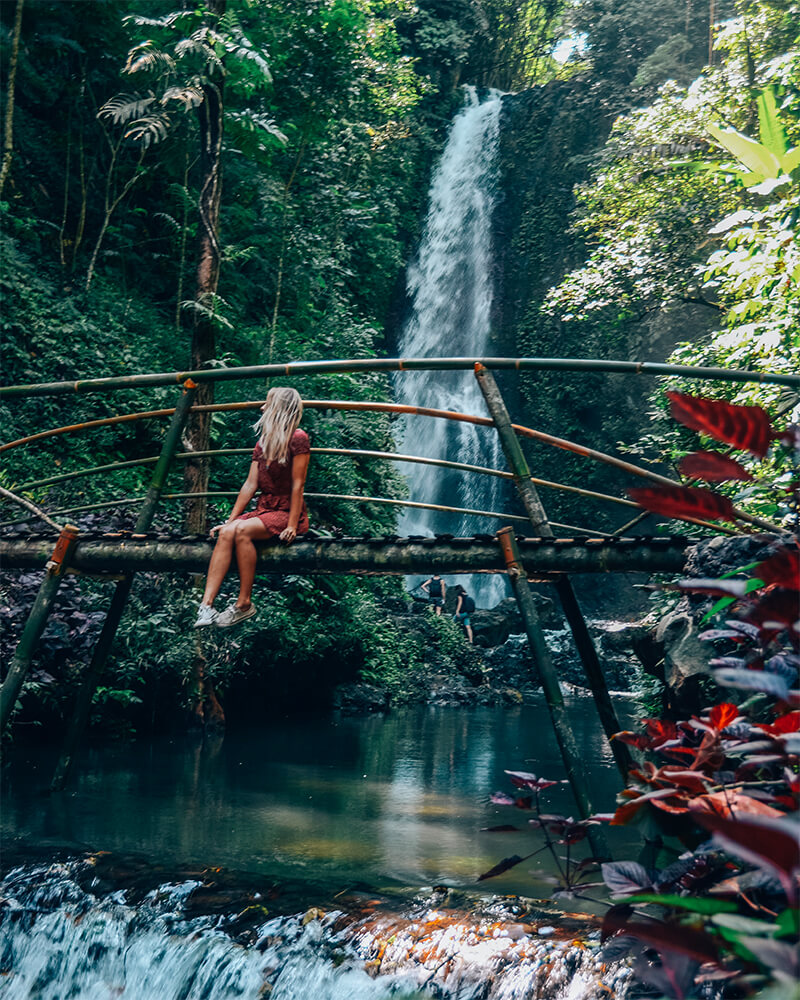 A small bridge near Munduk waterfall in Bali, me sat on it