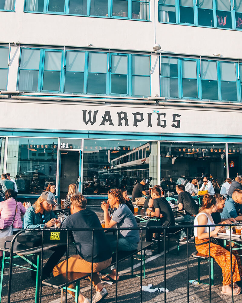 People sat outside Warpigs in the meat packing district in Vesterbro