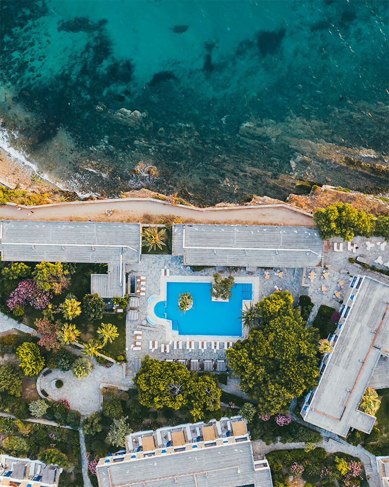 Drone shot of a hotel with pool and beach in Mykonos island in greece