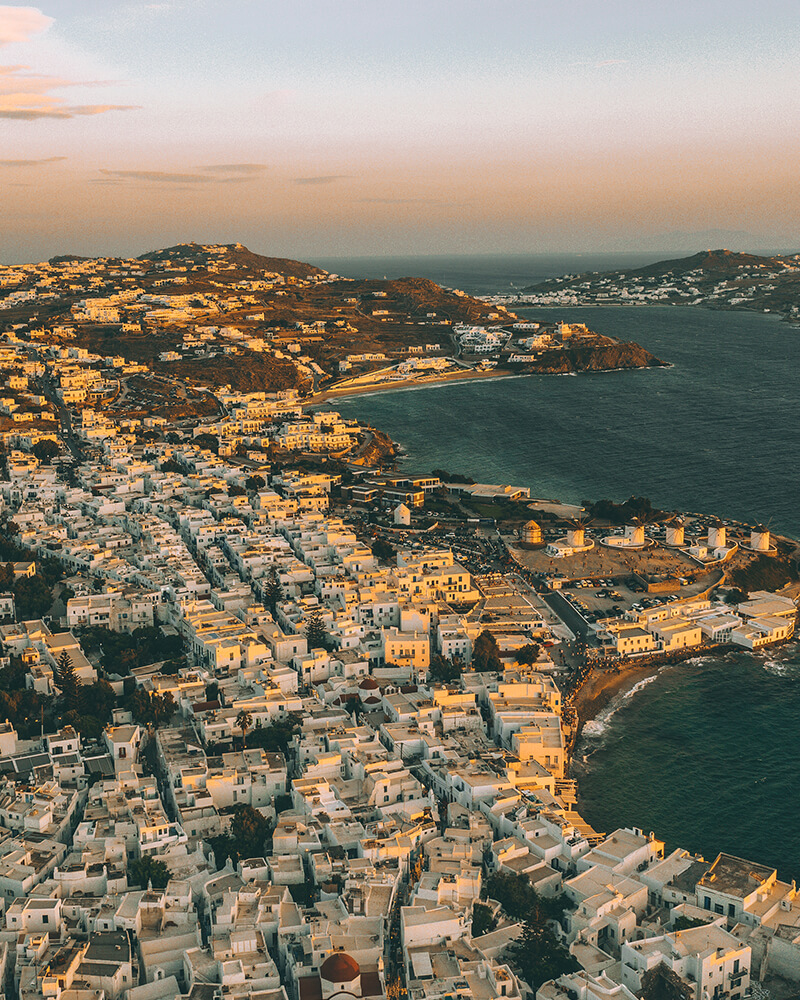 Sunset at Mykonos Town in mykonos Island, view from the drone