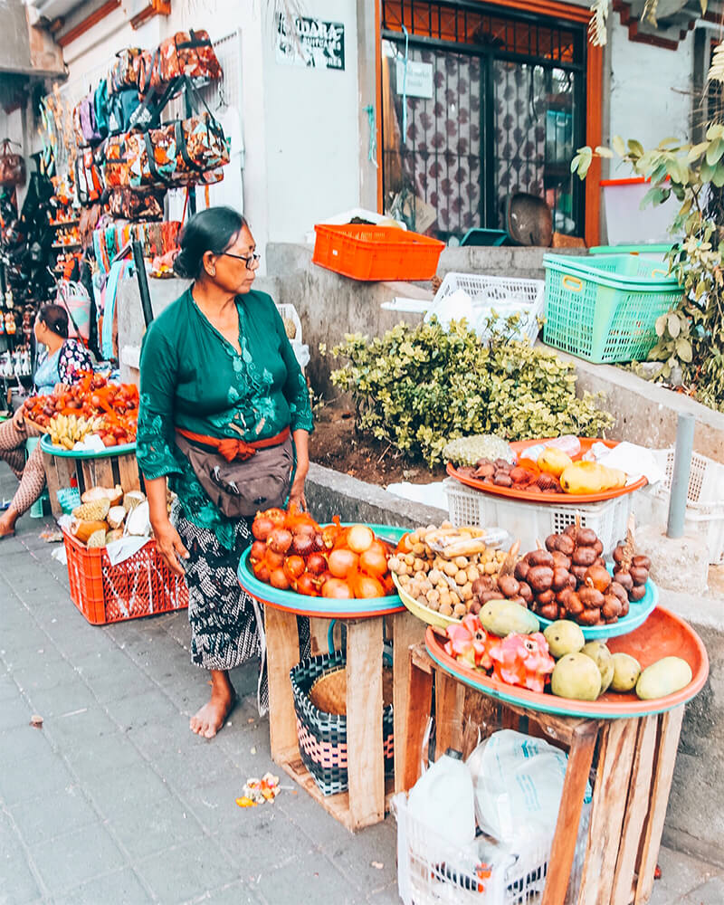 Lady selling fruit and vegetables at a local market in Ubud, Bali, Indonesia