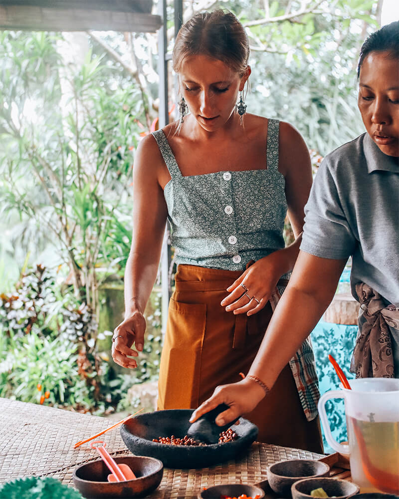 Cooking and crushing peanuts at a cooking class in Ubud, Bali, Indonesia