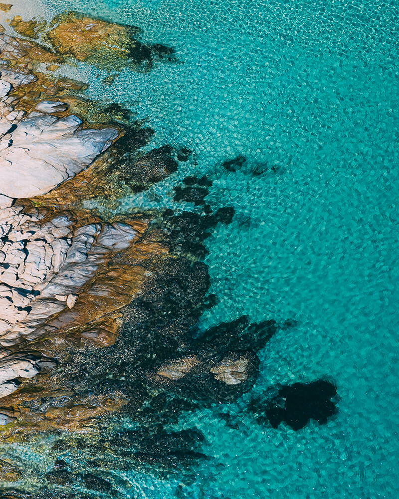 Drone shot of the rocks at Loulos beach, mykonos