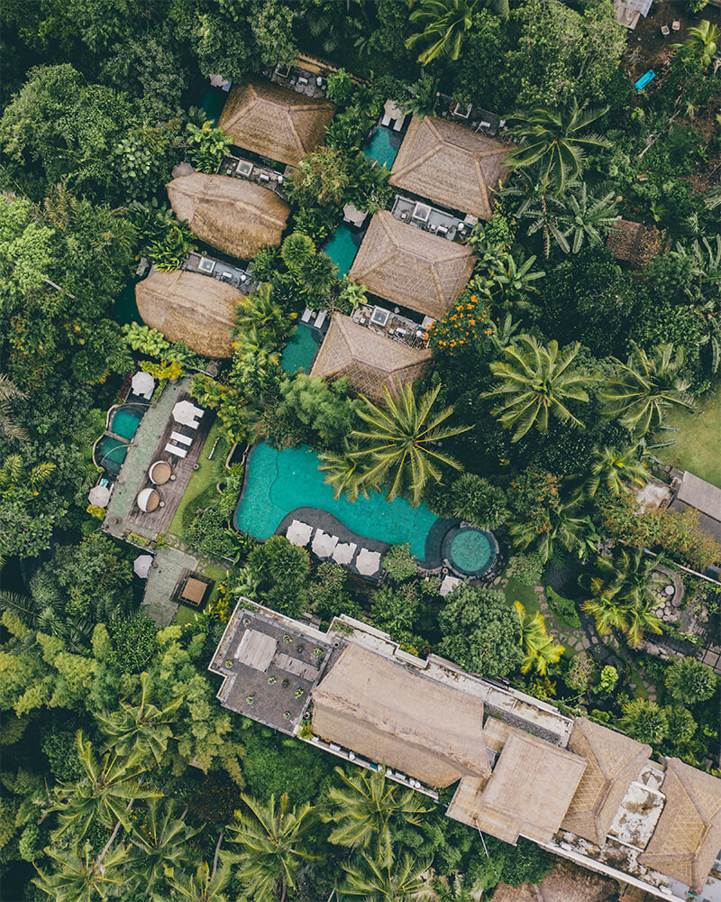Drone shot of the Udaya Hotel, a unique place to stay in Ubud, Bali. Also an instagrammable hotel in Bali! View of the pool and surrounding greenery