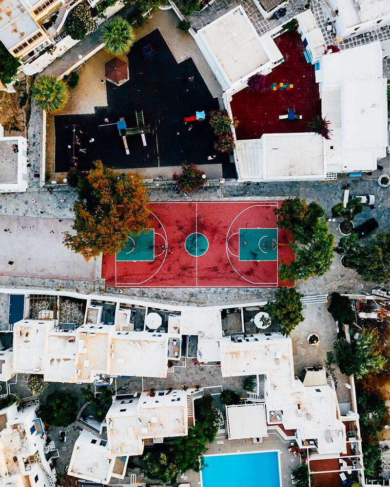 Top down of basketball court in the centre of Mykonos town, shot with the drone