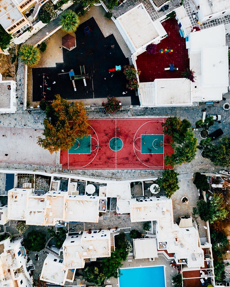 Drone shot of a basketball court in Mykonos, Greece