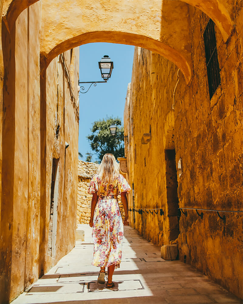 Me walking down a street in Victoria Citadel on a day trip to Gozo