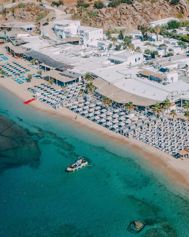 Where to party in Mykonos - Principote beach club photo taken with the drone of the sea and beach club