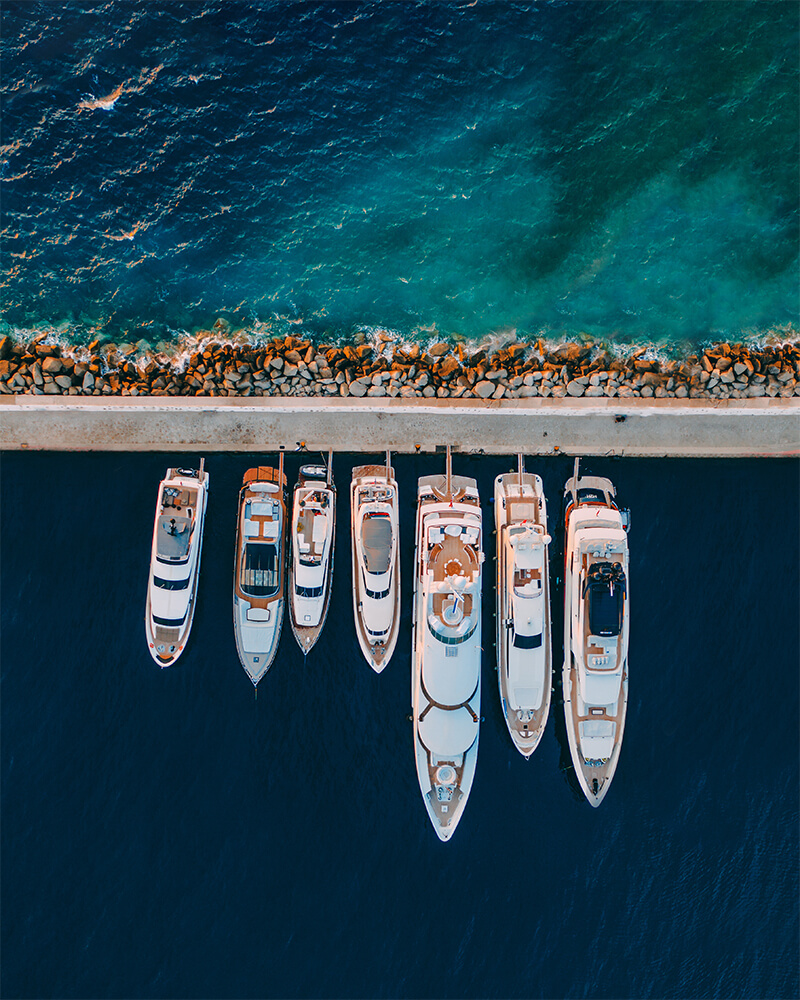 Top down of Mykonos harbour with yachts in a line