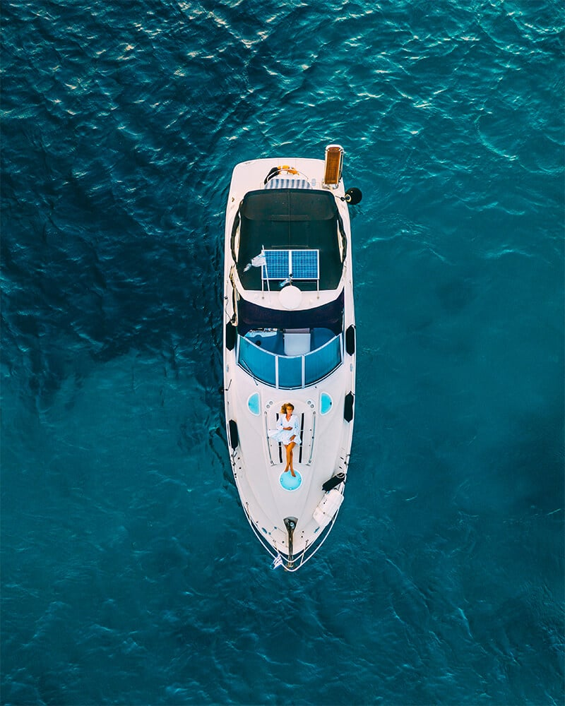 Drone shot of me on a boat in Mykonos out at sea