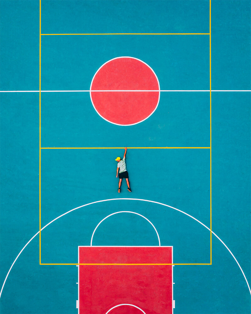 Top down drone shot, Boyan on a basketball court near to Ano Mera