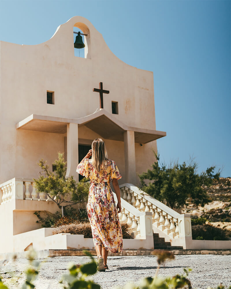 Me standing outside a church at Dwejra Bay, Gozo