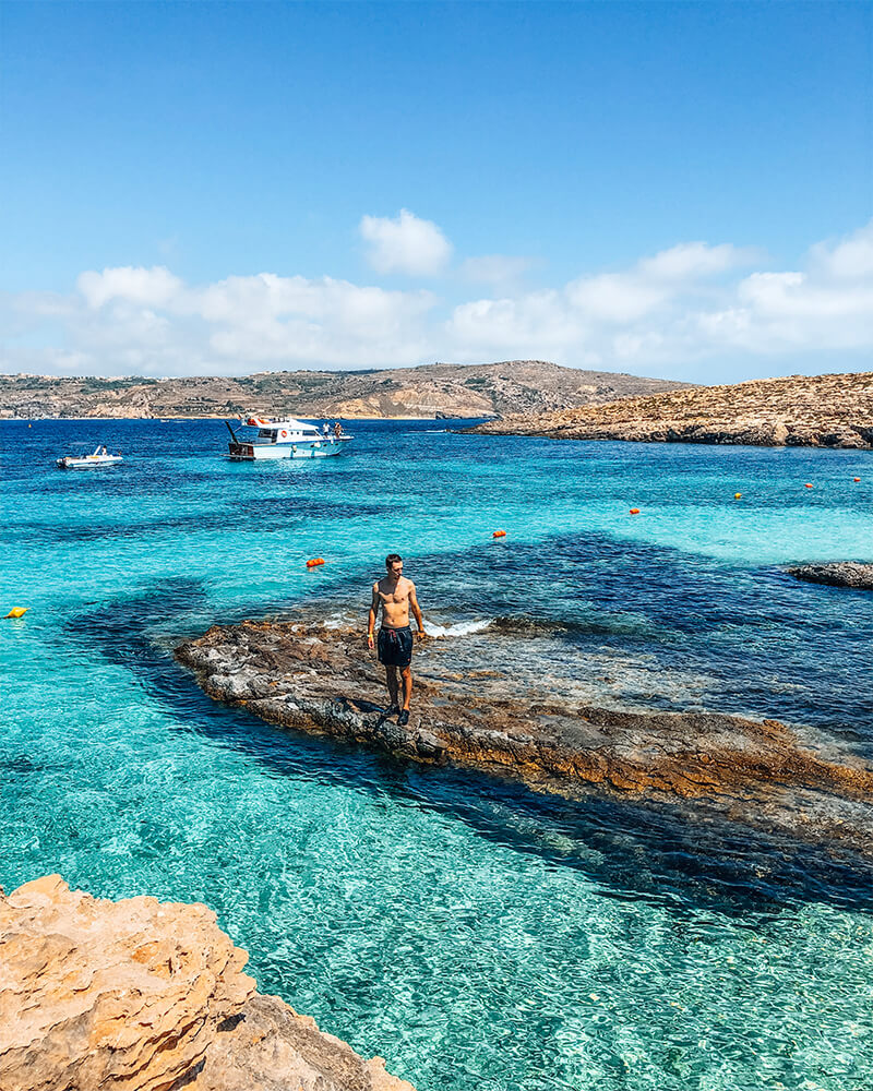 Boyan standing looking into the water during our day trip to Comino, Malta