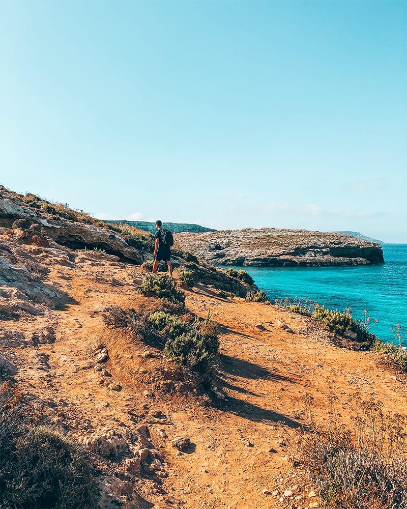 Boyan walking along the path on Comino in Malta