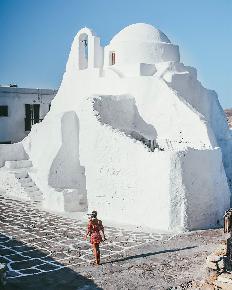 Panagia Paraportiani church in Mykonos Town, Greece. Me standing in front of the old white church - one of the best photography spots in Mykonos