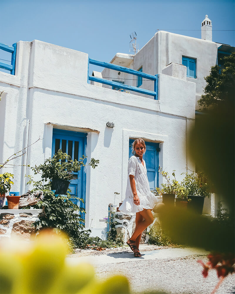 Me twirling in front of a white house in Mykonos, Greece