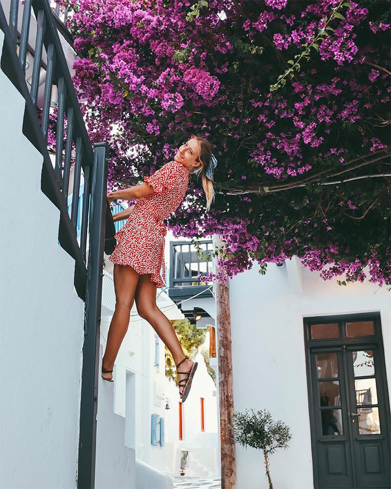 Me in front of a flowery street in Mykonos town