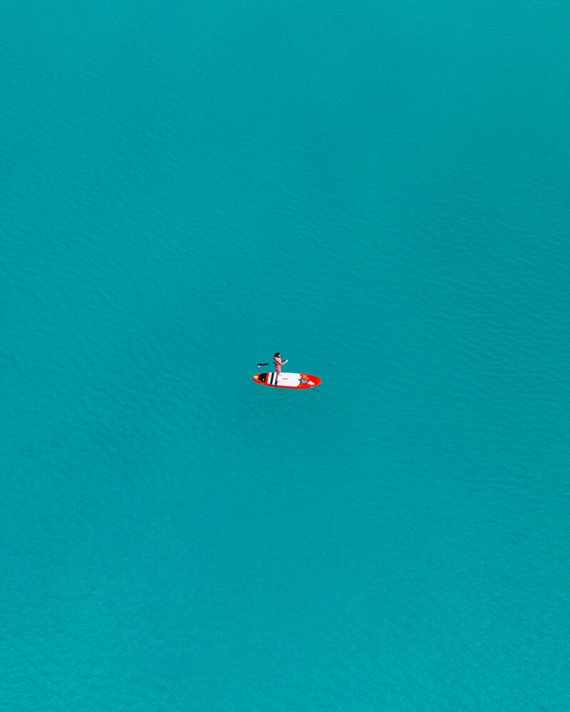 Paddle boarder on Schliersee Lake, Bavaria drone shot